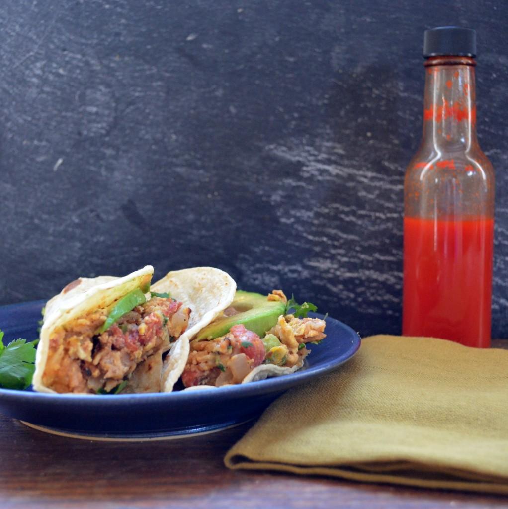 Migas breakfast tacos with habanero hot sauce